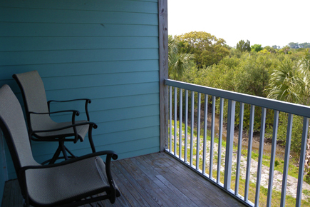 balcony with chairs overlooking the wetlands