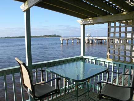 the private balcony with the fishing pier in the distance.