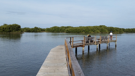 small fishing pier at the end of the boardwalk